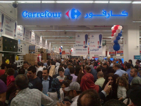 Carrefour Opens to Mass Crowds