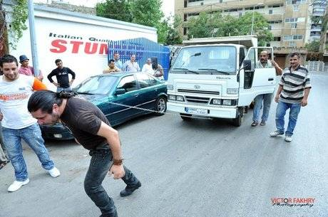 Lebanese Man Pulls Truck with Hair